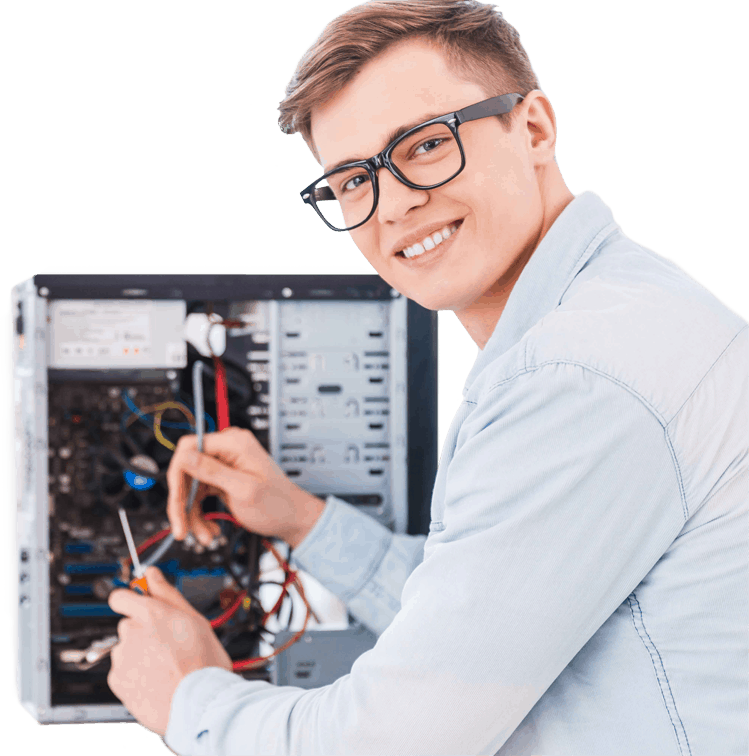 young-man-smiles-wearing-geeky-eyeglasses-wiring a desktop-tower